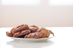 Chocolate cookies on white table Stock Images