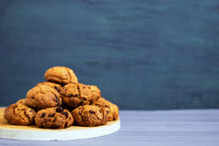 Chocolate cookies on white wooden stand and blue, purple background Royalty Free Stock Photography