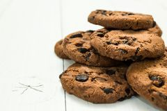 Chocolate cookies on a white wooden table, space for text royalty free stock photography