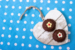 Chocolate heart. Chocolate cookies on wooden heart. top view Stock Photo