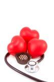 Chocolate, corações, e Stethos Imagens de Stock Royalty Free