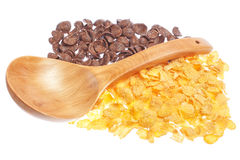 Chocolate and corn flakes with a wooden spoon. Stock Images