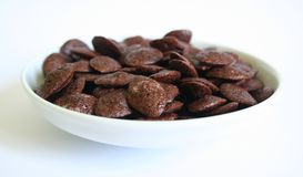 Chocolate cornflake. On a white plate Stock Images