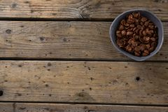Chocolate cornflakes in bowl. On wooden table Stock Photography