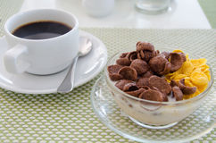 Chocolate cornflakes Corn flakes with milk and coffee Royalty Free Stock Images