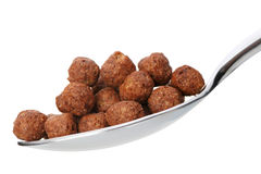 Chocolate cornflakes. A dry breakfast in a spoon. Stock Photography