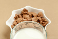 Chocolate cornflakes and milk glass Stock Photo