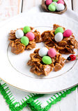 Chocolate and cornflakes nests with candy eggs Stock Images