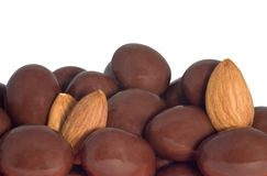 Chocolate covered almonds. And almonds isolated on white background Stock Photography