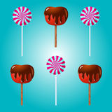 Chocolate covered apple and lollipop vector illustration. Chocolate covered apple and lollipop vector illustration on blue background Royalty Free Stock Photo