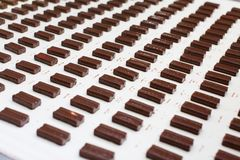 Chocolate covered candy at a candy factory. Hundreds of chocolate covered candy bars photographed at a candy factory Stock Images