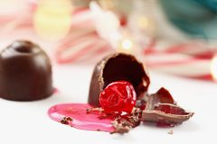 Two Chocolate Covered Cherries. Chocolate covered cherries. Shallow depth of field with selective focus on bitten portion of candy truffle with exposed cherry Royalty Free Stock Photo