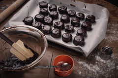 Chocolate covered christmas cookies. On table royalty free stock photography