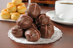 Chocolate covered cream puffs Stock Images