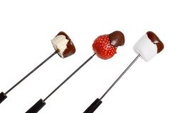 Chocolate covered food on fondue stick Stock Photography