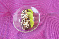 Chocolate Covered Kiwi. S on a clear plate on a pink background stock photography