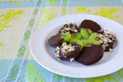 Chocolate Covered Kiwi. S on a white plate royalty free stock photos