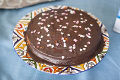 Chocolate covered love birthday cake. royalty free stock photography