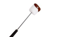 Chocolate covered marshmallow on fondue stick Royalty Free Stock Photography