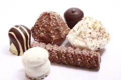 Chocolate covered meringue confection Stock Photos