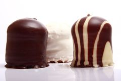 Chocolate covered meringue confection Stock Images