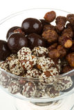 Chocolate covered nuts. On the white background stock photography