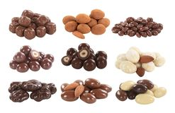 Chocolate covered nuts and fruit stock photos