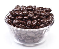 Chocolate covered raisins. Bowl of chocolate covered raisins, isolated on white stock photography