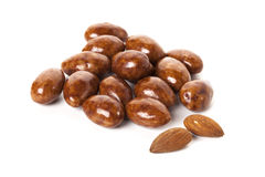 Chocolate covered roasted almonds isolated Royalty Free Stock Photography