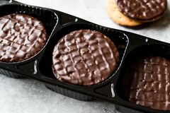 Chocolate Covered Round Jaffa Cookies in Plastic Box / Container. Dessert Concept Stock Photos