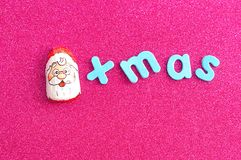 A chocolate covered with Santa Claus face wrapper with the word xmas Royalty Free Stock Photos