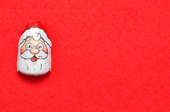 A chocolate covered with Santa Clause face wrapper Royalty Free Stock Images