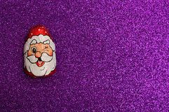 A chocolate covered with Santa Clause`s face wrapper Royalty Free Stock Image