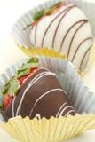 Chocolate covered strawberries. White and dark chocolate covered strawberries Royalty Free Stock Images