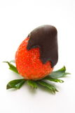 Chocolate covered strawberry. Delicious chocolate covered strawberry with green leaves stock photo