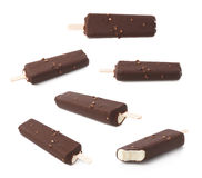 Chocolate covered vanilla ice cream bar. With nuts on a wooden stick, isolated over the white background, set of multiple different foreshortenings stock image