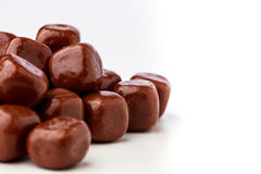 Chocolate covered wafers. Closeup stack of square chocolates off centre Stock Photo