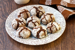 Chocolate crackle cookies. On plate Royalty Free Stock Photography