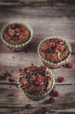Chocolate cranberry muffins. Chocolate muffins with red cranberries Stock Photography