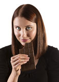 Chocolate craving. A beautiful woman satisfying a chocolate craving Royalty Free Stock Photos