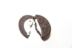 Chocolate cream biscuit. A biscuit is breaking in half Stock Images
