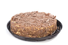 Chocolate cream cake with plastic dish on white Royalty Free Stock Photography