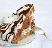 Chocolate and cream cake on the plate Royalty Free Stock Image