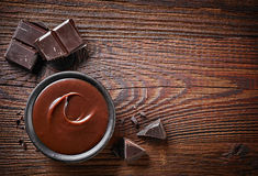 Chocolate cream and chocolate pieces Stock Images