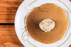 Chocolate cream with colorful sprinkles on the american pancakes Stock Photos