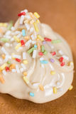 Chocolate cream with colorful sprinkles on the american pancakes Royalty Free Stock Images