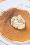 Chocolate cream with colorful sprinkles on the american pancakes Stock Photo
