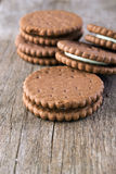 Chocolate cream cookies , close up. Chocolate cream cookies on the wooden table Stock Image