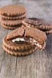 Chocolate cream cookies , close up. Chocolate cream cookies on the wooden table Stock Photos