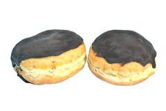 Chocolate cream donuts Stock Photos